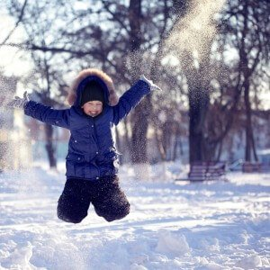 Kid jumping in snow